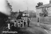 Children in the High Street, Stetchworth.  The Post Office is in the background on the right.  Courtesy: Cambridgeshire collection.