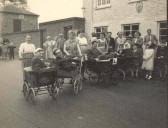 Charity pram race outside the Live and Let Live Pub, High Street, Stetchworth.