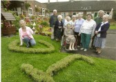 Stetchworth's Jubilee Court residents with the cup for Best Communal Garden.
