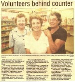 Volunteers behind counter at the Ellesmere Centre Shop Stetchworth.