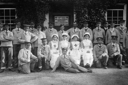 Soldiers and nurses outside the Swavesey V.A,D. Hospital.. Description