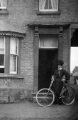 Phoebe Elizabeth Shepperson (nee Mitham) outside the Chequers Public House in Swan Pond, Swavesey.. Description