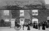 Webster Family in High Street, Swavesey in 1895.. Description