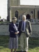 Ann & John Shepperson outside St Andrews church, Swavesey.. Description