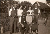 Gaunt Family by thatched stable (now demolished).Back:  Mr & Mrs F Chester (nee Kennell), Miss N, Miss A, Mr F GauntFront: Mr J, Ian, Mrs K Gaunt