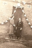 Coronation of George VI.  Misses K and N Gaunt outside 77 High Street, Upwood.. The picture shows Nell Gaunt with her mother Kate Gaunt (nee Kennell) outside 77 High Street, Upwood