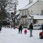 Life in 2009.  Snowball fight in Cross Keys car park and along High Street, Upwood