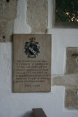 Upwood Church.  Plaque commemorating the 20th century restoration of one of the Norman windows in the Chancel.
