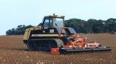 Allan Burton preparing the soil for Rape seed with Cat 75 & 6m Maschio power harrow, by Redland Hill Spinney Great Raveley