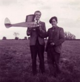 Fred Deighton & Slim (Rob) Summerville with Model Aircraft in the field next to the cemetery