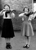Ann Ellington, and Daphne Barham playing the violin at School