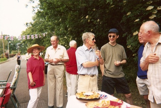 Our village millenium party held in broadway - the road was closed to traffic - anybody could join in - people bringing their own food to enjoy