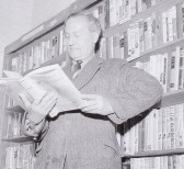 Mr Iliffe Norfolk, local village historian, browsing through the books in Wilburton Library.