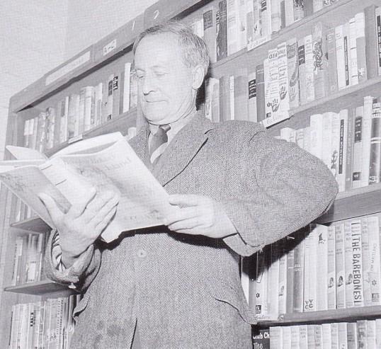 Mr Iliffe Norfolk, local village historian, browsing through the books in Wilburton Library.