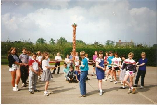 Wilburton school children dancing around the maypole