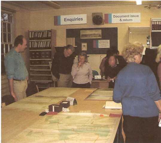Wilburton archive group collecting information  for the web site on visit to Cambridgeshire Archives