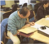 Steve, Wilburton group Treasurer taking notes at Cambridgeshire Archives