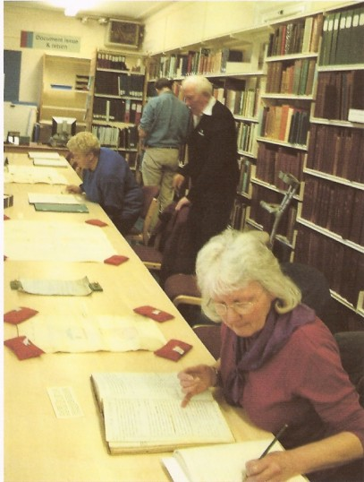Wilburton group visit to Cambridgeshire Archives with Joy our Chairlady taking notes for the group