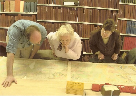 Group visit to Cambridgeshire Archives, Jenny Pauline & Steve studying old maps of Wilburton
