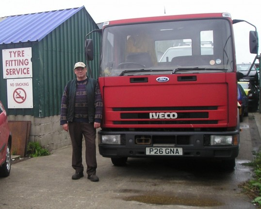 Mr R Northcote with one of his lorrys in the recycling yard in Grunty Fen, Wilburton