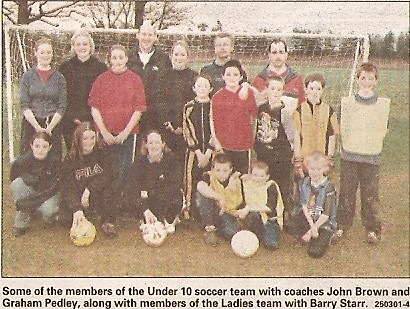 Members of Wilburton under 10 soccer team with coaches John Brown & Graham Pedley