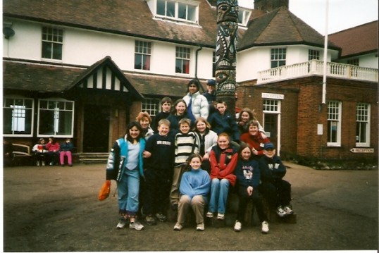 Wilburton school children on an outing with the headmistress.