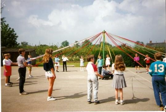 Dancing around the Maypole at Wilburton School