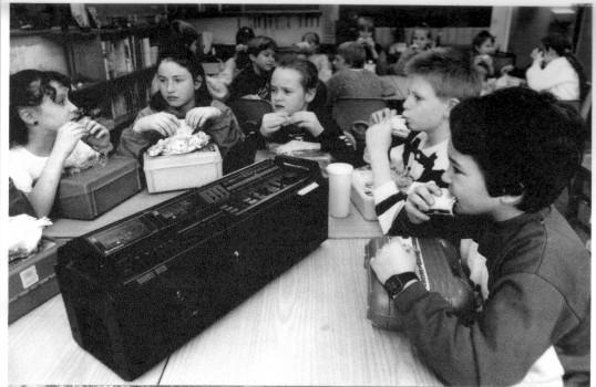 Wilburton School Children relaxing in their lunch time.view www. cambridge- news.co.uk