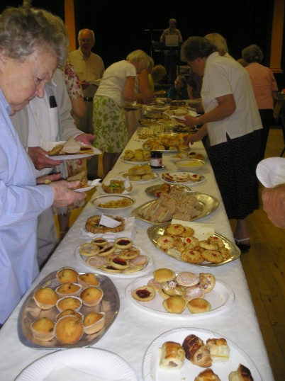 A group of members of the over 60s club enjoying their tea