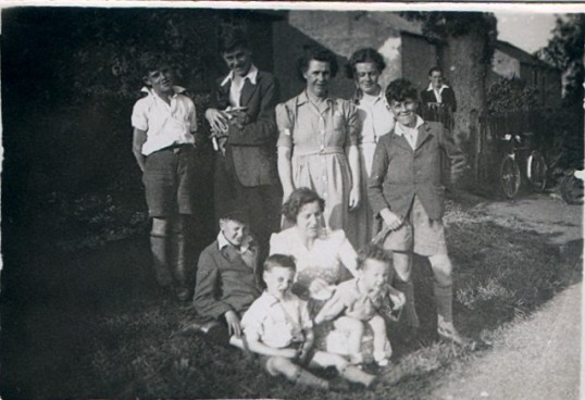 The Day family relaxing outside of their gate at no 3 Stretham Road, Wilburton