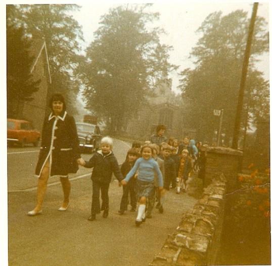 Wilburton school children leaving Church on their way back to school