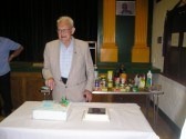 Frank Yarrow cutting his birthday cake at his party with the St Peter's Over Sixties Club