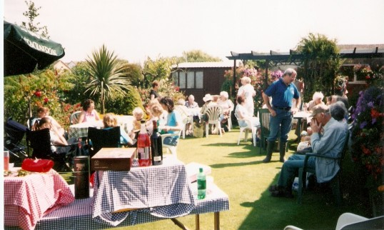 A coffee morning to raise funds for cancer research held in Wiggy Robinsons garden