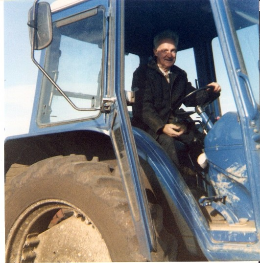 Frank Yarrow at work on a tractor