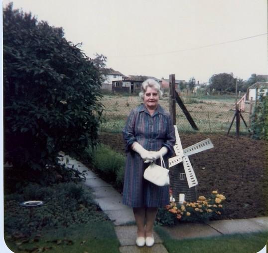Mrs Frank Yarrow in their garden  at Wilburton.