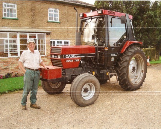 Mr Keith Ladson with his new tractor, a replacement for the tractor he lost in the farm fire earlier this year