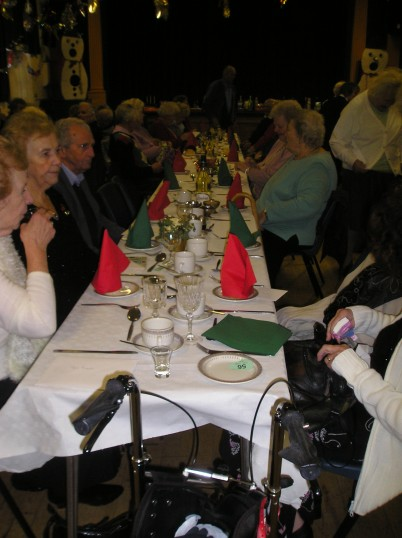 Some of St Peter's club members sitting down to Christmas lunch