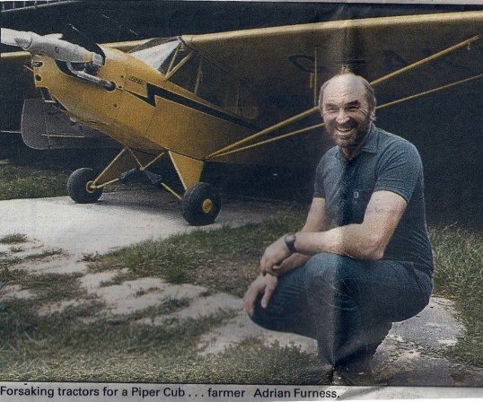 A local farmer & his plane: Adrian Furness just after landing his plane on his farm in Wilburton