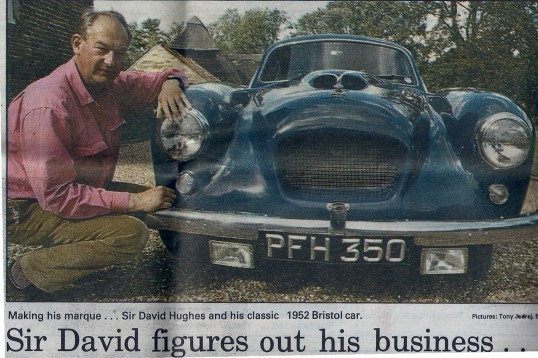 The Late Sir David Hughs at his home, the Wilburton Manor house, with one of his classic cars a 1952 Bristol