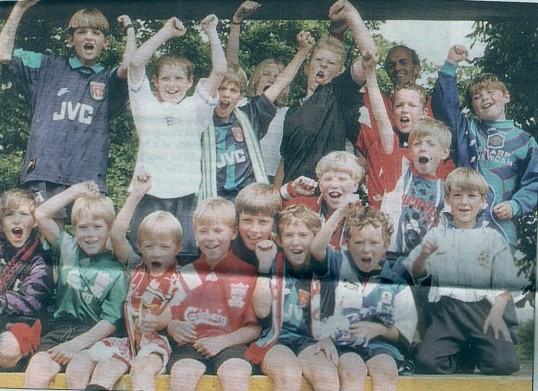 (Footy Fever) Players of the newly formed Wilburton Colts Football Club on a disco float in the Feast parade in Wilburton