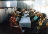 A group of over sixties members enjoying tea on one of their outings