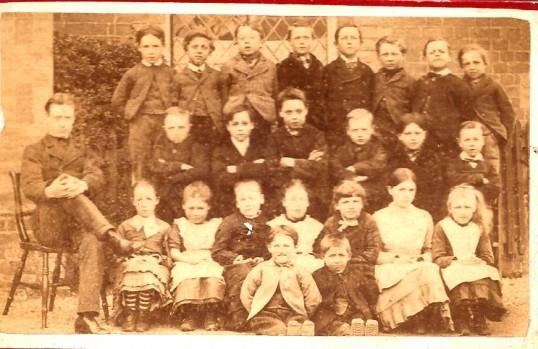 Wilburton school children with  their teacher in the  late1800s