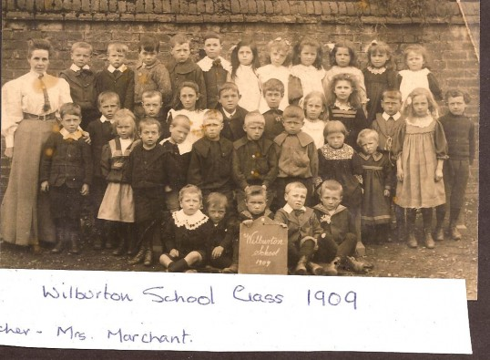 Mrs Marchant with her class in 1909