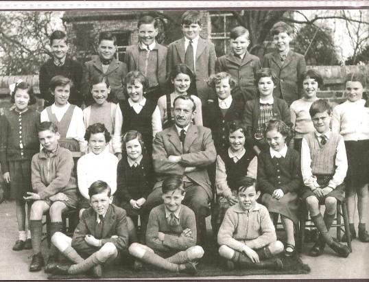 Mr Gothard, Head teacher, with a group of his children