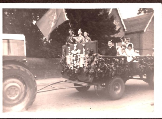 A Wiburton  Feast parade with the girl guides
