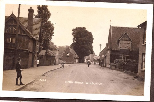 Wilburton High Street with the Red House on the left and the village hall on the right
