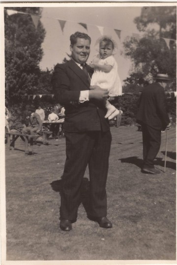 Vic Payne holding Vivian Day at a garden fete on Wilburton playing field