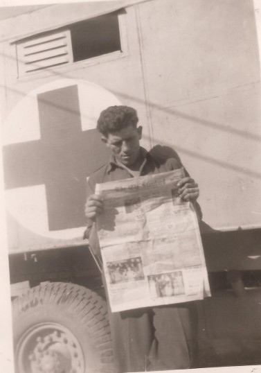Gordon (Pop) Day reading the Ely Standard while in the army in Egypt