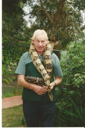 Don Day with a snake around his neck when he worked at the reptile centre