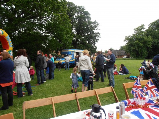 Ice cream van in the back ground at the jubilee party every child recieved a free ice cream